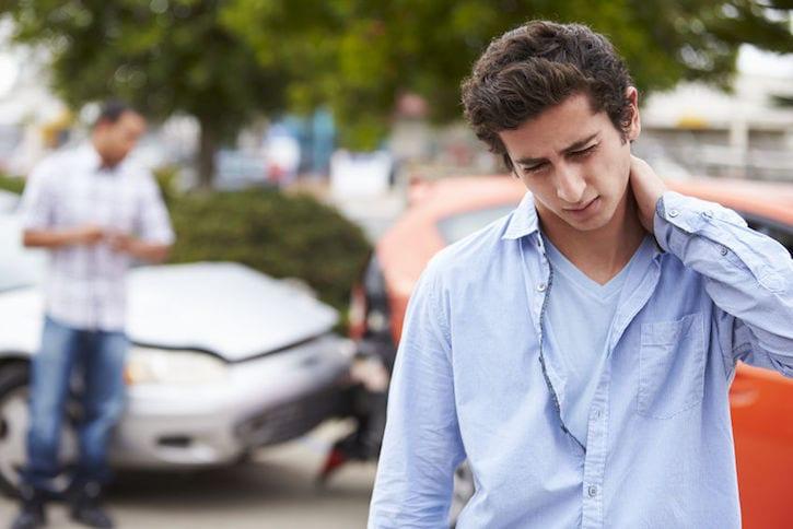 42310015 - teenage driver suffering whiplash injury traffic accident