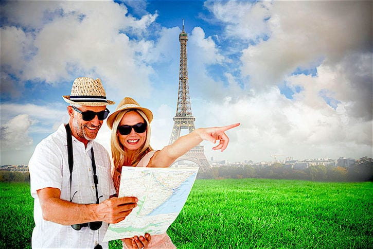 35902368 - happy tourist couple using map and pointing against eiffel tower